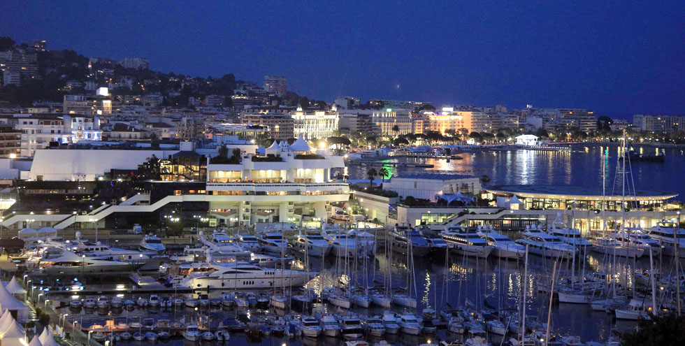 Boats are seen moored in the harbour of Cannes near the Festival Palace, before the start of the 64th Cannes Film Festival in Cannes May 9, 2011. The Cannes film festival runs from May 11 to 22. Picture taken May 9, 2011.     REUTERS/Jean-Paul Pelissier (FRANCE - Tags: ENTERTAINMENT CITYSCAPE)