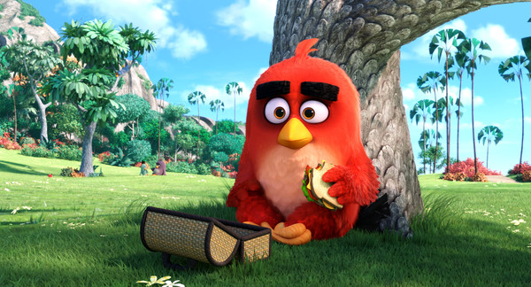 Red (Jason Sudeikis) enjoys lunch alone in the park in Columbia Pictures and Rovio Animation's ANGRY BIRDS.