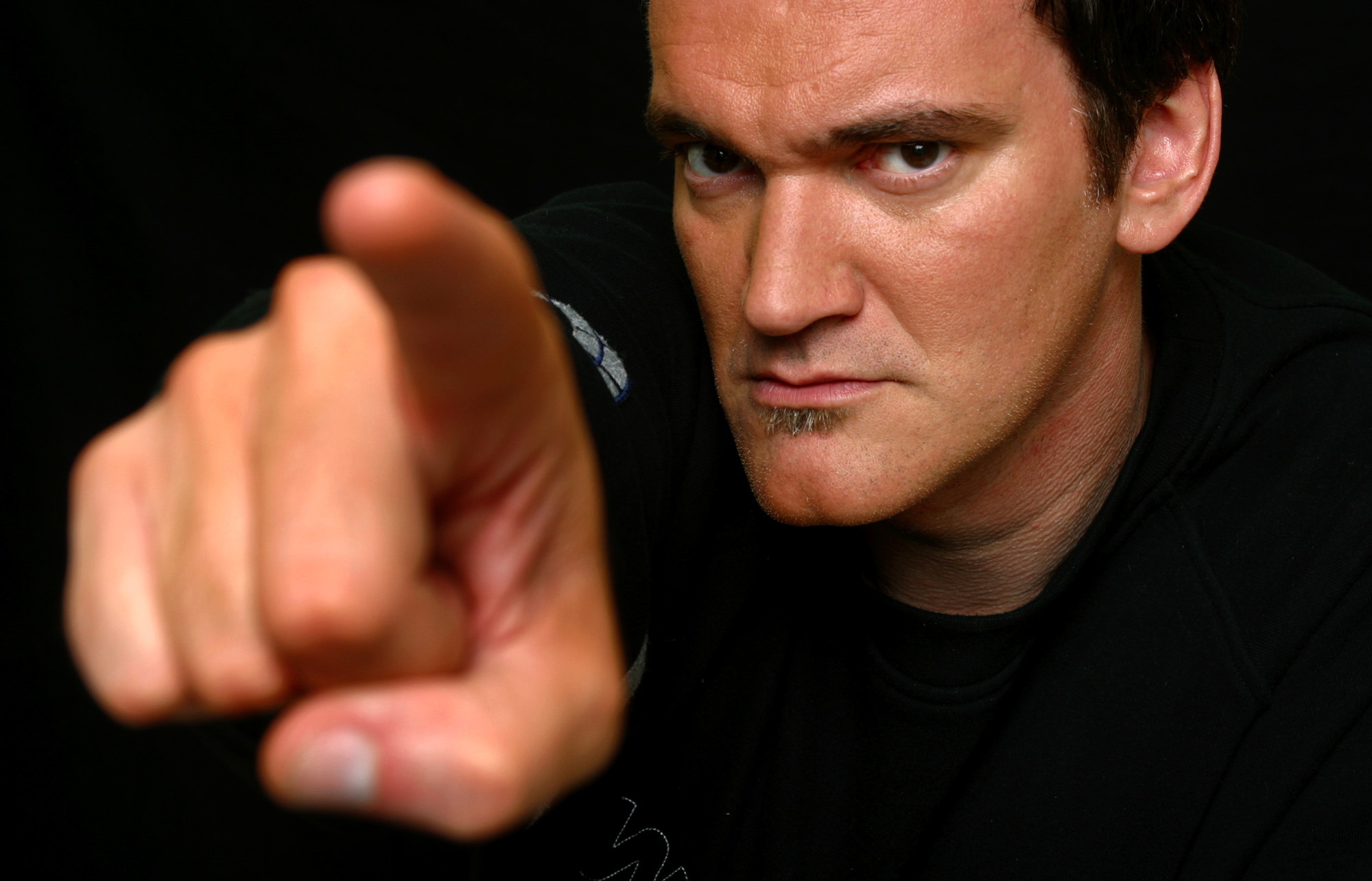 """Writer-director Quentin Tarantino is shown in this portrait taken at the Four Season Hotel in Beverly Hills, Calif., Friday, Sept. 26, 2003. Tarantino returns to the big screen after a six-year absence with his two-part action saga, """"Kill Bill"""".  (AP Photo/Stefano Paltera)"""